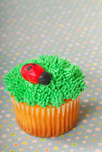 Cupcake decorated with grass frosting — Stock Photo