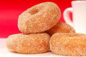 Apple cinnamon doughnuts with coffee — Stock Photo