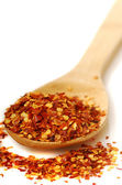 Spoon of red pepper flakes — Stock Photo