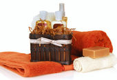 Skincare products with towels and soap — Stock Photo