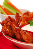 Chicken wings with dipping sauce — Stock Photo