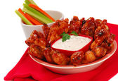 Chicken wings and dipping sauce — Stock Photo
