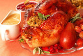 Turkey with stuffing, gravy and cranberry sauce — Stock Photo