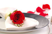 Red rose on a dniner plate — Stock Photo