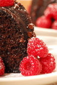 Chocolate fudge cake with raspberries — Stock Photo