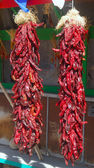 Hanging red chili peppers — Stock Photo