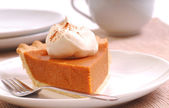 Slice of pumpkin pie with whipped cream — Photo