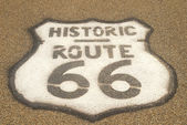 Route 66 sign on pavement — Stock Photo