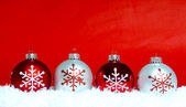 Christmas ornaments on snow — Stock Photo