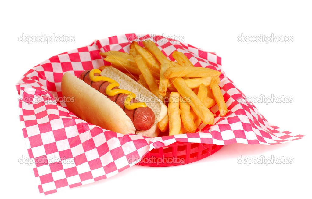 Freshly grilled hot dog with mustard and french fries in a serving basket — Stock Photo #5979510