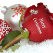 Stock Photo: Red Rose that says Merry Christmas on it