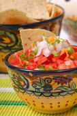 Spicy salsa with tortilla chips — Stock Photo