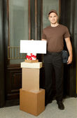 Friendly delivery man — Stock Photo