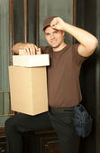 And his cap in front of a door — Stock Photo
