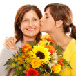 Kissing her mother — Stock Photo