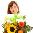 Brunett woman with bunch of flowers — Stock Photo
