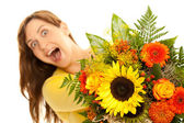 Young woman holding flowers in the camera — Stock Photo