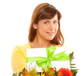 Beautiful young woman holding flowers. — Stock Photo