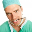 Scalpel in his mouth — Stock Photo #6121935