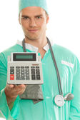 Doctor with calculator — Stock Photo