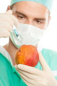 Injection and apple — Stock Photo