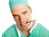 Scalpel in his mouth — Stock Photo