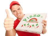Pizzaboy with pizza — Stock Photo