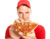 Pizza in his hands — Stock Photo