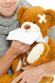 Man with tissue and bear — Stock Photo