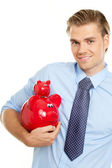 Man holding two piggybanks — Stock Photo