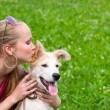 Stock Photo: Girl kissing puppy