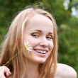 Young woman with camomile - Stock Photo