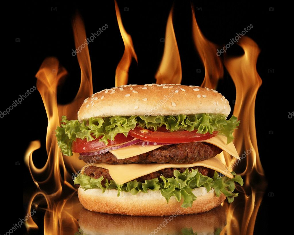 Delicious hamburger with fire flames on background  Stock Photo #5979949