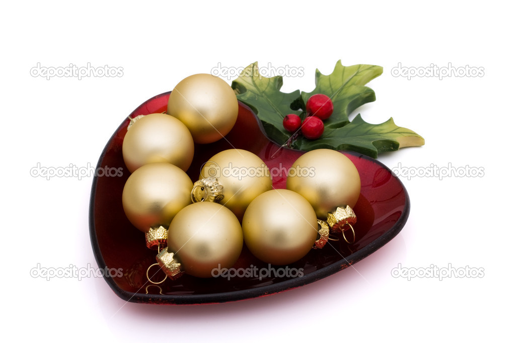 Christmas ornaments on a heart shaped red dish isolated on white, Christmas Ornaments — Stock Photo #5998835
