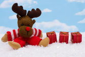 Reindeer with gifts — Stock Photo