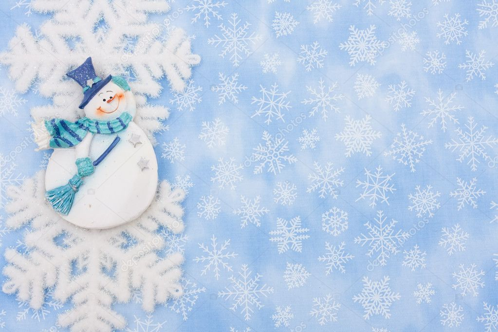 A snowflake and a snowman on a blue snowflake background, Christmas Time — Stock Photo #6326448