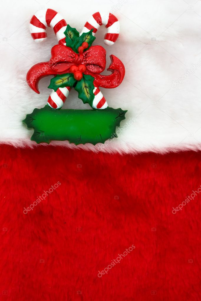 Two candy canes with a bow  on a red textured background, Candy cane  Stock Photo #6326484