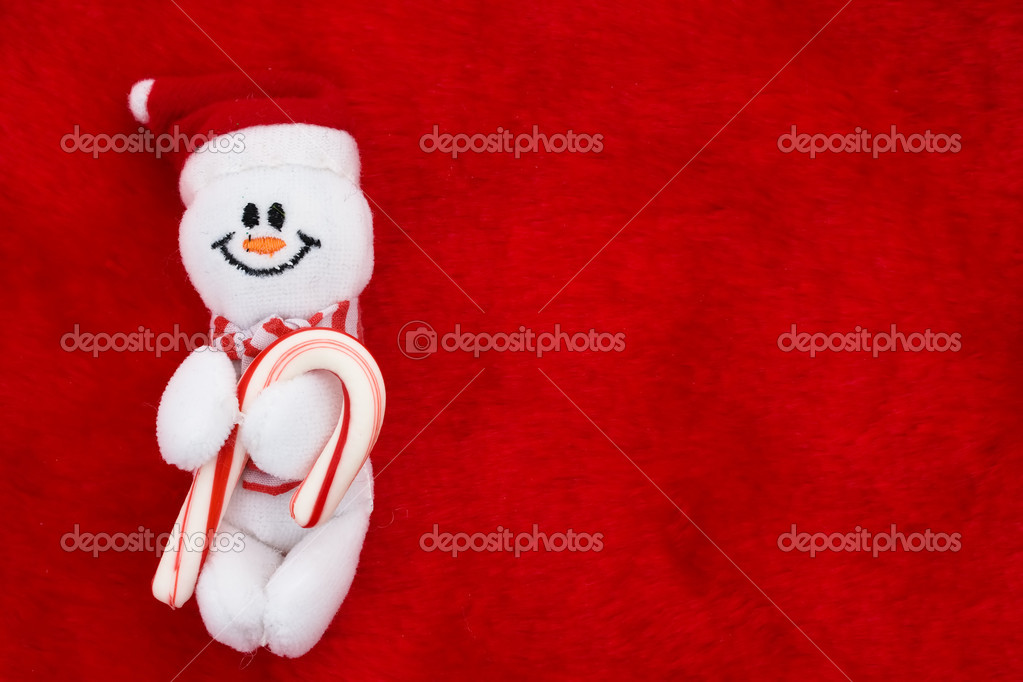 A snowman with a candy cane on a red background, Christmas Time — Stock Photo #6326489