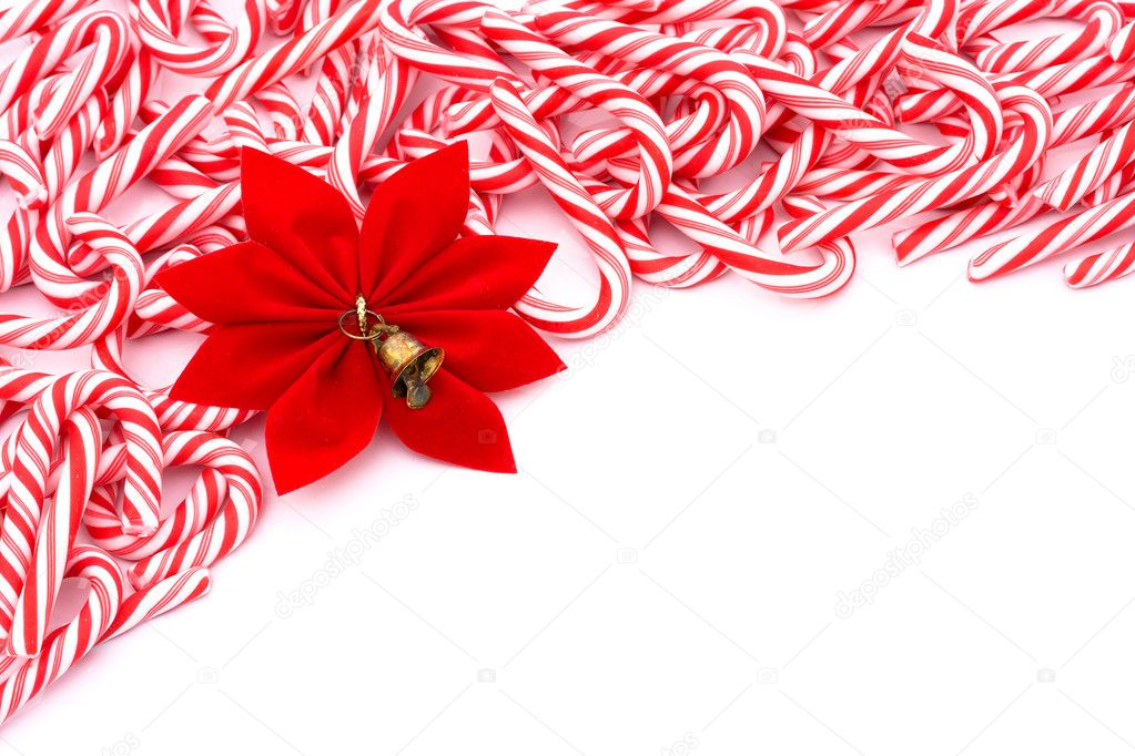 Mini candy canes making a border on a white background, Christmas Time — Stock Photo #6326503