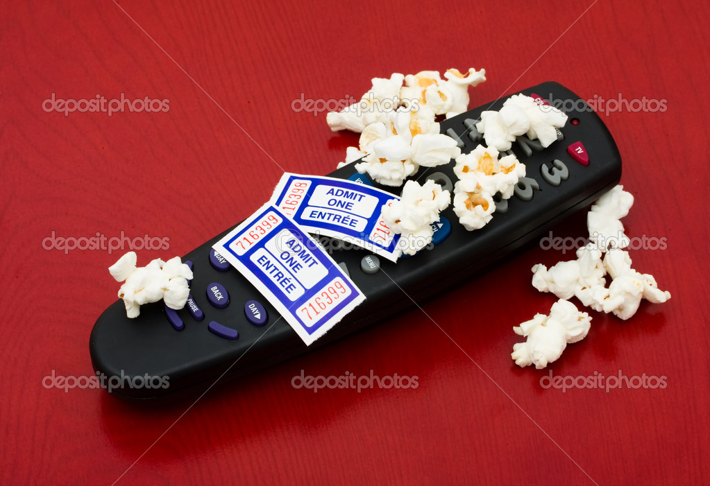 Popcorn and tickets with a remote control on a wood background, Home entertainment — Stock Photo #6403811