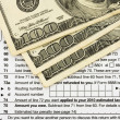 Stock Photo: Calculating your tax refund