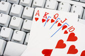 Playing poker online — Stock Photo