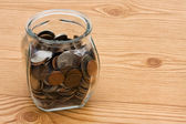 Saving money in your change jar — Stock Photo