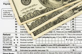 Calculating your tax refund — Stock Photo