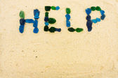 Help in the sand — Stock Photo