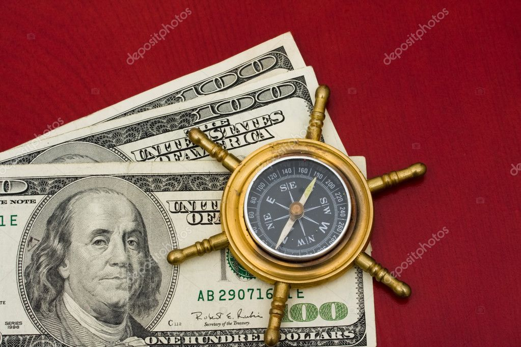 A compass sitting on one hundred dollar bills on a red background, Navigating your finances — Stock Photo #6455858