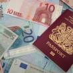 UK passport and euros — Stock Photo