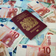 Stock Photo: uk passport and euros