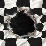 Checkered flag hole — Stock Photo