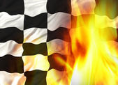 Chequered flag on fire — Stock Photo